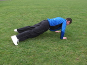 Man Using Arc In the Park to Keep Fit