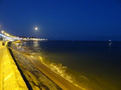 Exmouth beach after dusk, and the moon is up.
