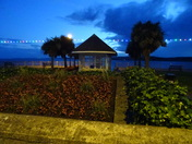 """The gardens opposite the """"Ocean Bowl & Grill"""" in the twilight"""