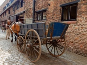 Horse and cart on the old cobbled street