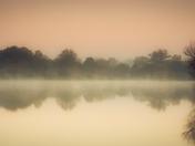 Sunrise over Hatfield Forest lake