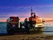 Exmouth RNLI All Weather Lifeboat R & J Welburn launching at dusk