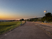 Sunset over Battery Point, the promenade and the lake grounds.
