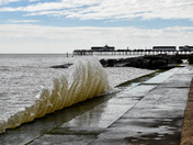 Southwold pier with wave in foreground