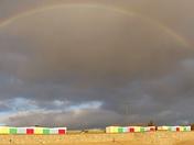 Exmouth rainbow over beach huts.