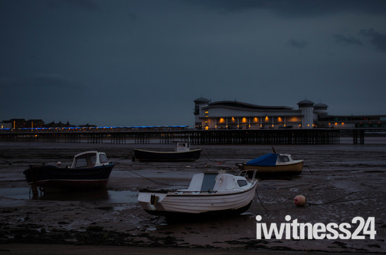 Boats on the mud, and the pier