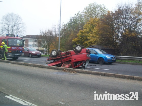 Overturned small van on the A12.