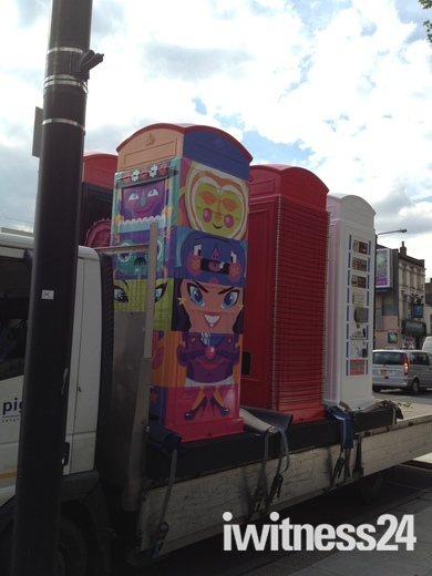 Colourful phone boxes being delivered