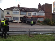 Lorry crashes into house on A12