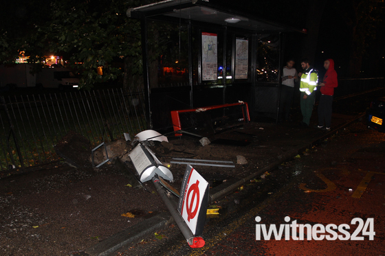 Bus Stop wrecked in Car Crash