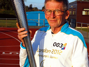 Bill and a Paralympic Torch