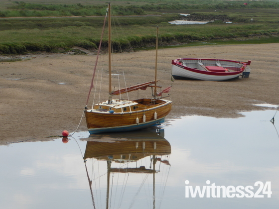 Reflectons of resting Boats at Burnham Overy Staithe