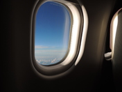 Looking through the cabin window somewhere over the Atlantic Ocean