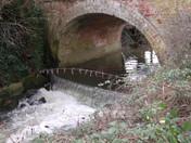 Waters flowing under bridge Station Hill Harleston