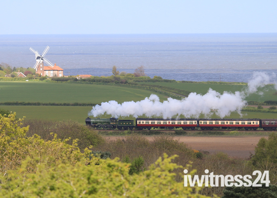 North Norfolk Railway and Weybourne windmill taken from Sheringham Park