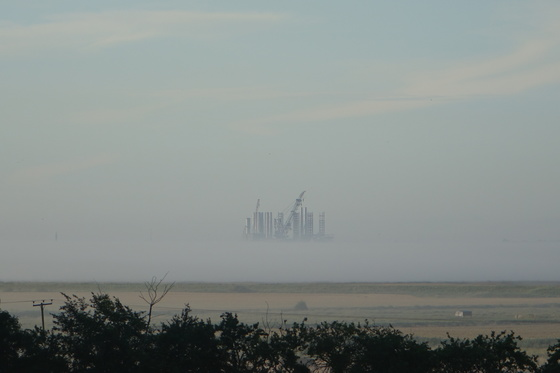 Barge carrying wind turbines off Great Yarmouth...Floating above the mist (taken