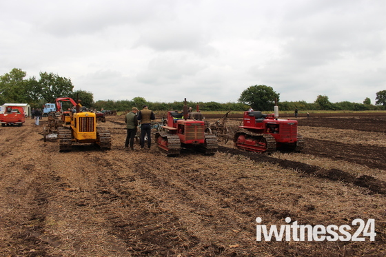 Crawler tractors from the 1940`s and 1950`s  on a tracks working day.