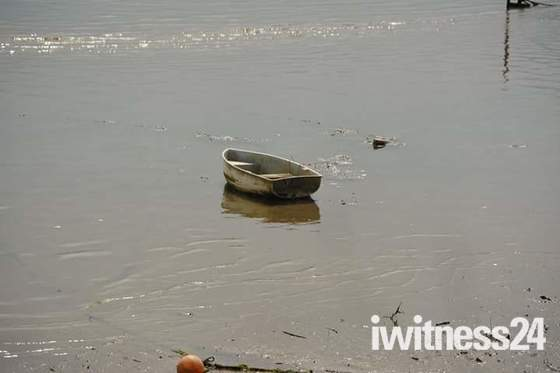 A lonely rowing boat near the Waterside Café near Chivenor