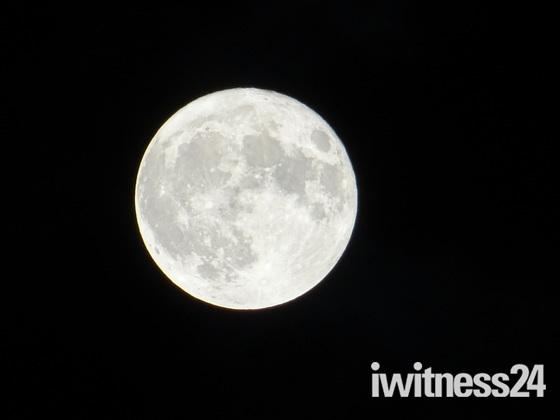 "The ""Supermoon"" full moon high in the sky"