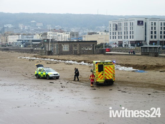 Incident on the Beach.