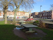Exmouth Strand with puddles by the table tennis tables.