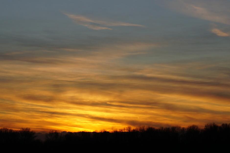 gesluierde zonsondergang