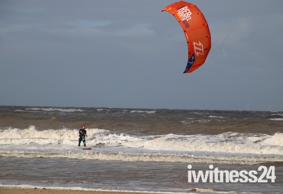 Something Red: Kite Surfer