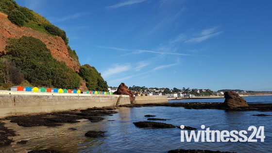 Blue skies over the beach huts at Dawlish