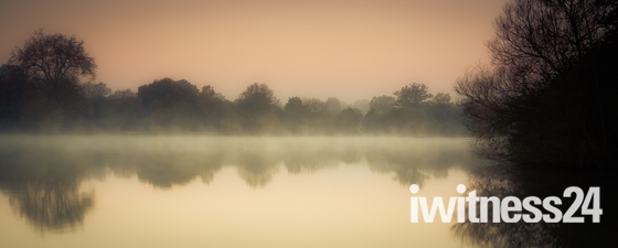 Sunrise over Hatfield Forest lake
