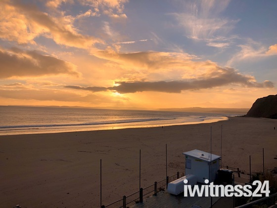december sunset at sandy bay beach