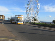 A bus approaches the stop outside the Exmouth Wheel.
