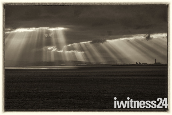Sunbursts over the Welsh coast