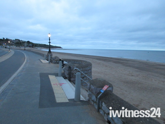 Looking towards Orcombe Point on a cloudy summer's evening.