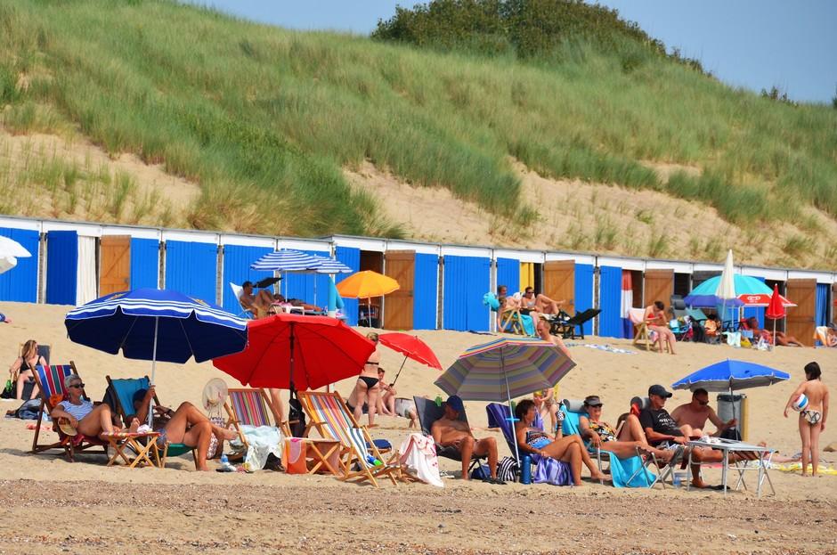 Parasol mee naar het strand