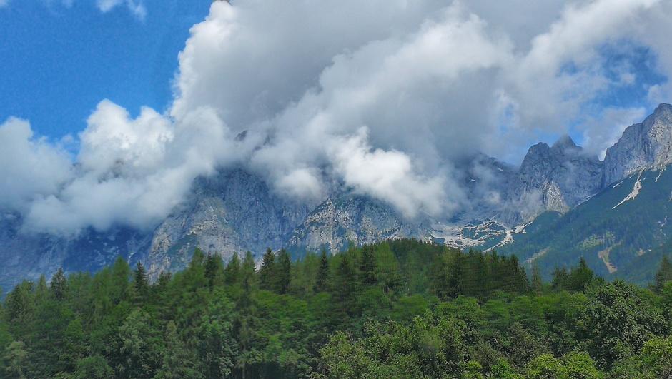 Wolken op de Alpen