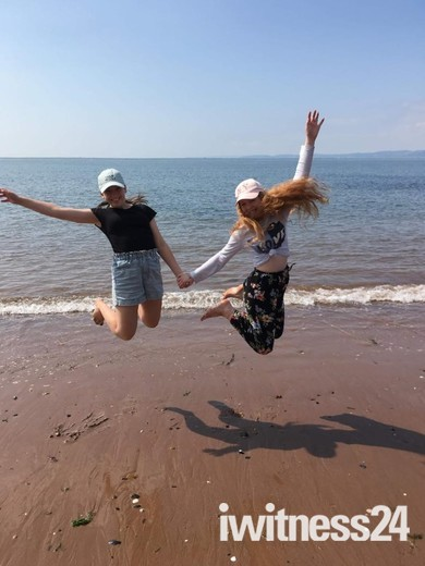 Jumping for joy on Exmouth beach