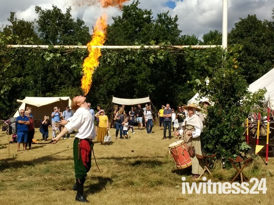 Fire eater performs at the Kett Fun Day and Fayre Wymondham