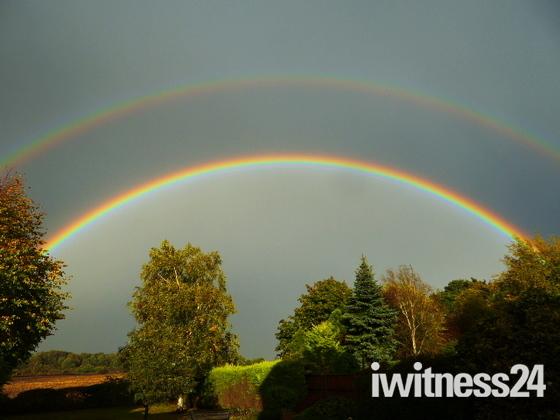 Mirror rainbow overlooking a field in Drayton