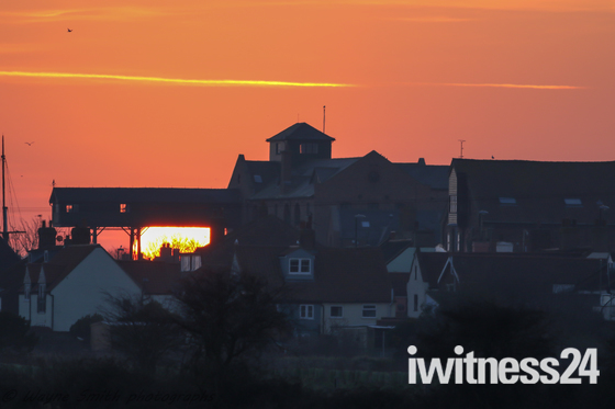 Sunrise over wells