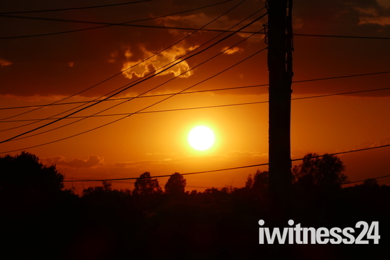 PROJECT 52, ORANGE. SUNSET THROUGH THE WIRES