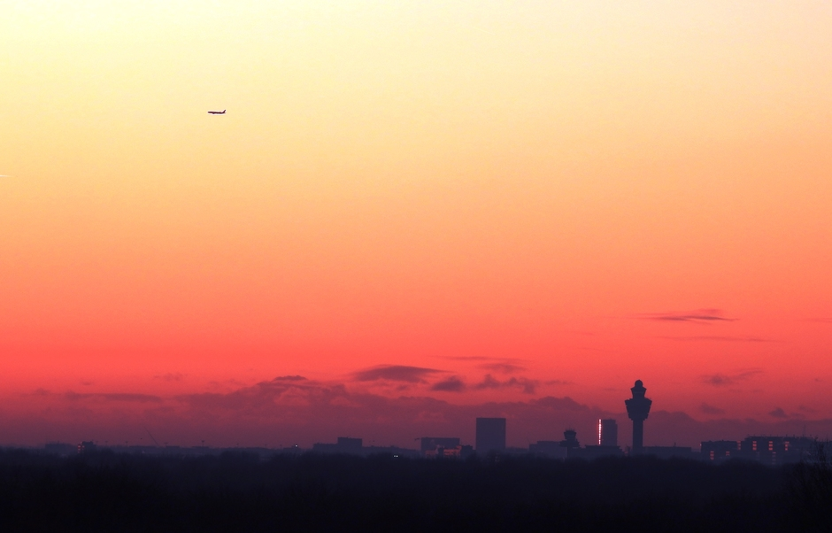 zonsondergang richting Schiphol airport
