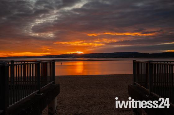 Exmouth December sunset looking across to Dawlish Warren.