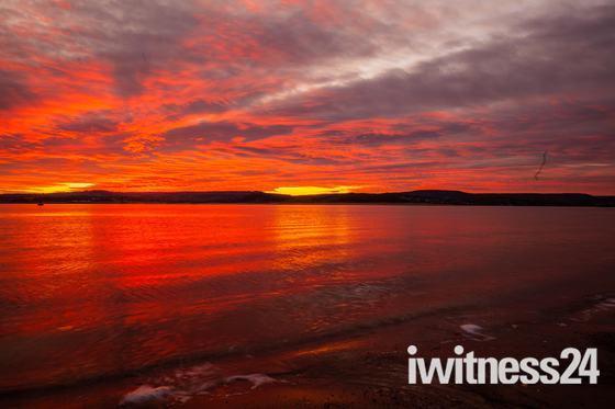 Exmouth December sunset looking across to Dawlish Warren.