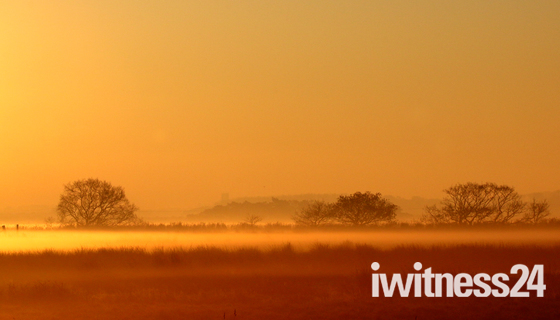 A view from Horsey with Winterton church on a misty,frosty morning