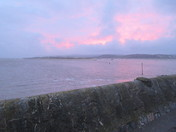 Pink sky after dusk across the sea