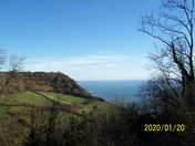 A sea view from the footpath through Dunscombe Caravan Park.