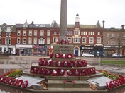Exmouth Strand Memorial reflecting on the wet paving slabs
