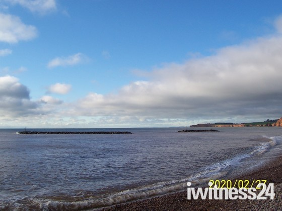Sidmouth beach with the clouds