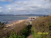 A view across the bay towards Dawlish from the cliff top footpath at Orcombe