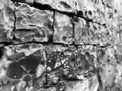 PROJ 52, DEPTH OF FIELD, KNAPPED FLINT WALL